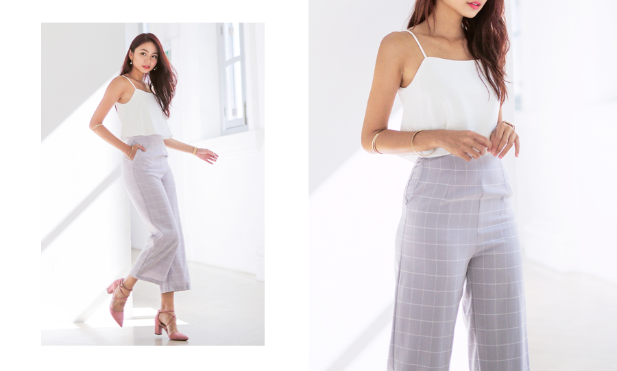 9bfae456b9 Work two contrasting shades in this grid jumpsuit! Finished in fun and  flirty grid patterns with white flare top